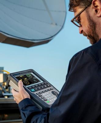 Rohde & Schwarz ZNH series handheld vector network analyzer in use